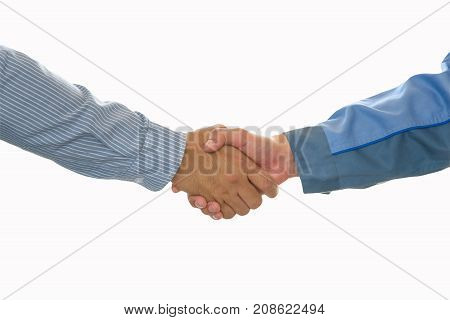 Business people shaking hands after closing deal in office partnership merger and acquisition concept