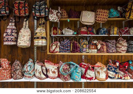 NESEBAR BULGARIA - AUGUST 21 2017: Handbags and backpacks with traditional Bulgarian patterns. Handmade. Showcase of a private shop selling souvenirs and gifts.