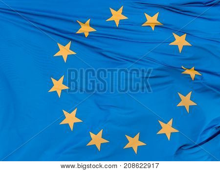 European Union flag on blue sky background close up