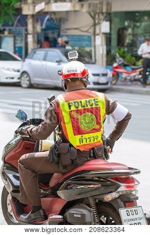 Thailand police on duty with motocycle and action camera on the head - Bangkok Thailand August 2016.