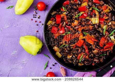 Stewed Black Beans With Sweet Peppers And Tomatoes With Spicy Sauce In A Pan. Flay Lay. Top View