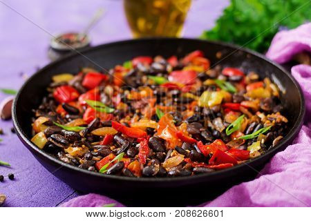 Stewed Black Beans With Sweet Peppers And Tomatoes With Spicy Sauce In A Pan.