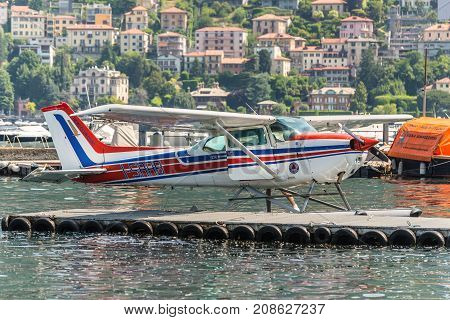 Como Italy - May 27 2016: A seaplane Cessna 172N Skyhawk 100 II docking on at water aerodrome of Como lake in Como City Italy.