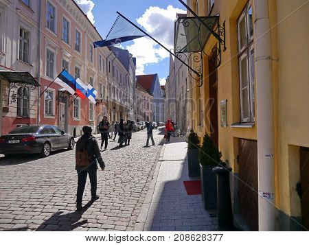 Tourirts in the street of Old Tallinn, Estonia, spring 2017