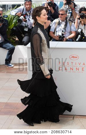 CANNES, FRANCE - MAY 19, 2016: Marion Cotillard attends the 'It's Only The End Of The World (Juste La Fin Du Monde)'  photocall. 69th annual Cannes Film Festival at the Palais des Festivals
