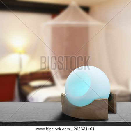 Colored Air Freshener In Glass Container In Cosi Vintage Bedroom