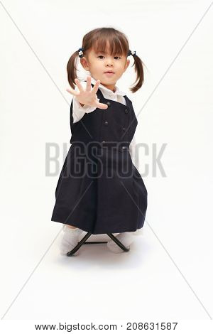 Japanese Girl On The Chair Playing Rock-paper-scissor In Formal Wear (2 Years Old) (paper)