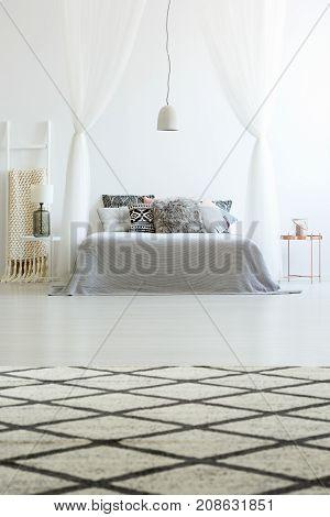Patterned Carpet In Spacious Bedroom