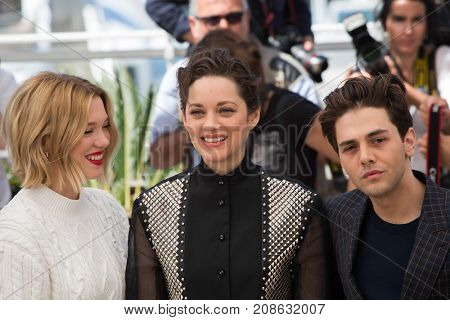 CANNES, FRANCE - MAY 19, 2016: L. Seydoux, M. Cotillard, X. Dolan attend the 'It's Only The End Of The World '  photocall. 69th annual Cannes Film Festival at the Palais des Festivals