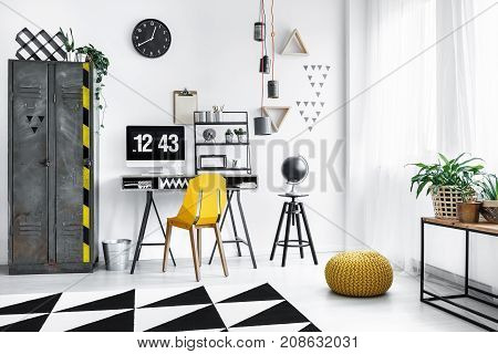 Yellow Pouf In Designer Workspace