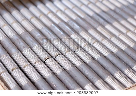 Tubes With Threaded Threads. In Production. Finished Parts In A Row
