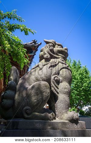 Lion Statue In Ushijima Shrine Temple, Tokyo, Japan