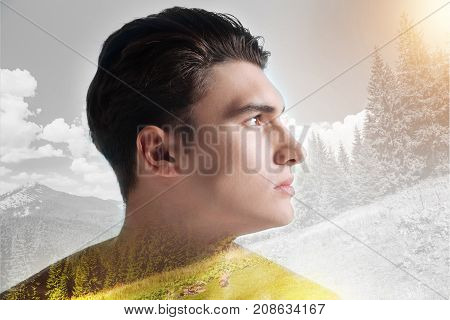 Being far away. Close up of confident boy standing against nature background while looking at the distance