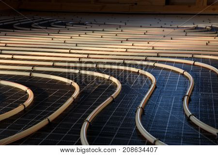 Construction of house. Tubing are elements of radiant floor heating system