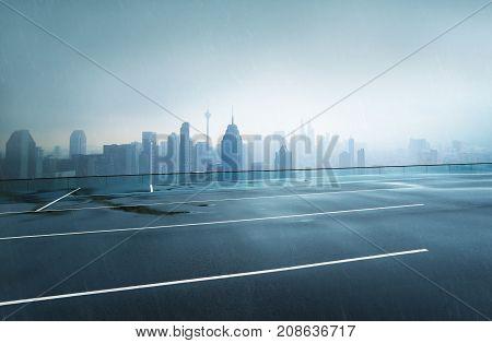 Empty wet asphalt road with foggy city skyline background raining day .