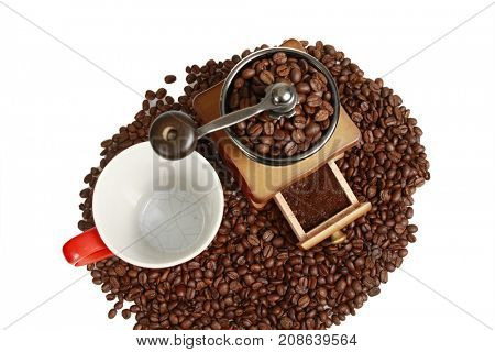 Vintage manual coffee grinder with coffee beans,top view