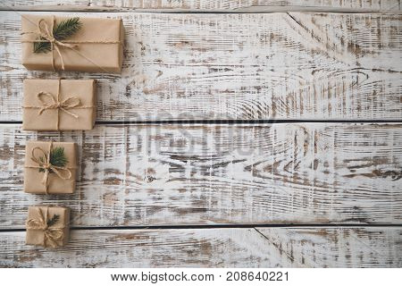 Christmas Background. Christmas Composition. Christmas Gift, Pine Cones, Fir Branches On Wooden Whit