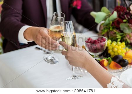 Celebration Of The Wedding Day With Glasses Of Champagne. The Bride Is Toasting With Champagne