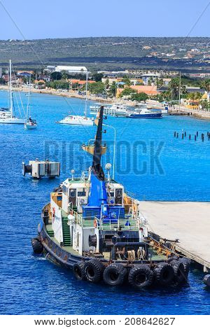 A Large Tugboat Docked at Bonaire Pier