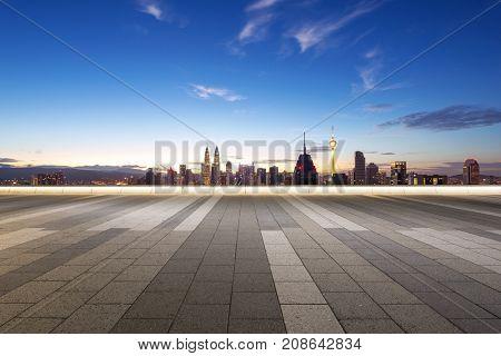 empty marble floor and cityscape of kuala lumpur at twilight