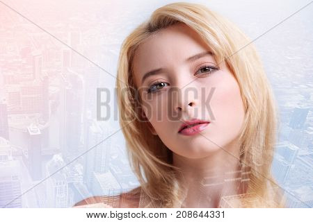 Best girl ever. Close up of beautiful model with makeup looking at you while standing against urban background