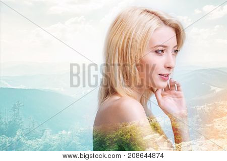Time for relax. Close up of gorgeous girl looking away while touching her face and smiling