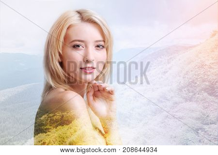High spirits. Close up of positive model looking and you and expressing cheer while standing against pleasant picturesque