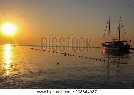 Sunset. Beautiful sunset at baltic sea. Gold sea sunset. Picture Sea sunset. Sea sunset background. Wonderful sea sunset Sunset sea picture. Sunset sea waves. Summer sunset.