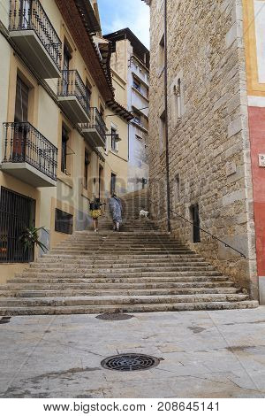GIRONA, SPAIN - MAY 14, 2017: This is one of the steep streets of the old city.