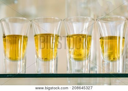 Catering Services. Celebration. Glasses With Alcohol Placed On The Glass. Five Glasses Of Alcohol.