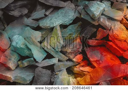 Cracks of vibrant sandstone. The pattern of the variegated sandstones. Layers of toned colored mica stones. Rock Landslide. Shiny silicate mineral storage space of various fantastic sandstone