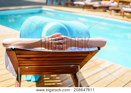 Relaxing Woman Near Luxury Swimming Pool.