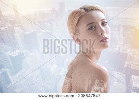 Time for relaxation. Close up of charismatic girl looking at you while having peaceful mood