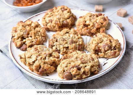 Oatmeal cookies with chocolate chips and raisin close up view