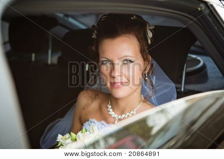 Portrait Of A Pretty Bride In A Car
