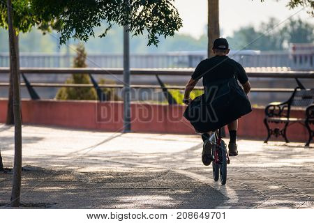 Rear View Of Mature Man Cycling in the city. Copy space for text