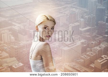 Time for leisure. Close up of charming girl walking through the city while having positive mood