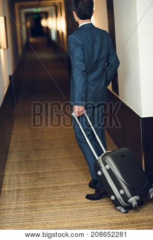Businessman With Suitcase Walking In Hotel