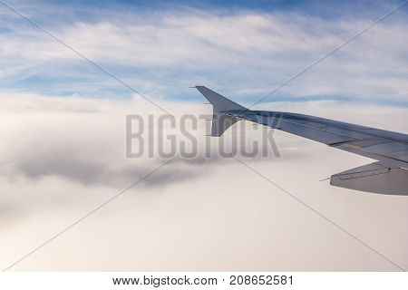 A lot of clouds seen from plane window