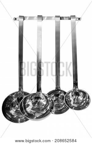 silver metal soup ladle on white background