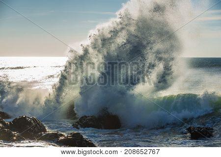 Waves of Atlantic Ocean crashing on rocks in Porto Portugal