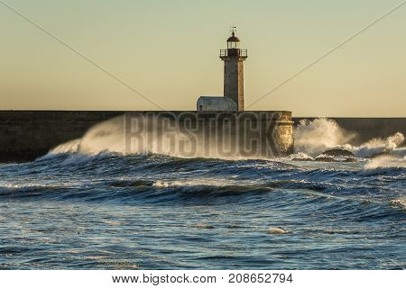 Felgueiras Lighthouse seen from beach in Porto city Portugal