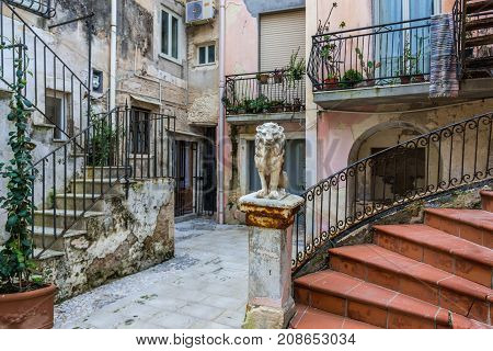 Town houses courtyard on the old part of Syracuse - Ortygia isle Sicily Italy