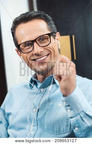Businessman Wearing Earbuds
