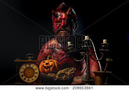 Halloween Devil Man With Pumpkin, Clock, Candlestick On Table
