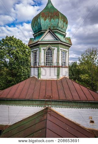 Old wooden Orthodox church in Krasne deserted village of Chernobyl Exclusion Zone Ukraine