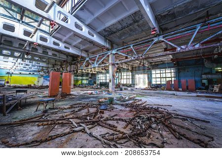 Hall in factory building in abandoned Pripyat city in Chernobyl Exclusion Zone Ukraine
