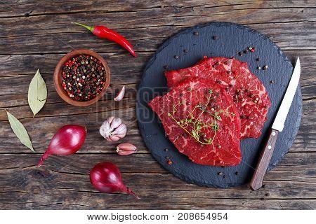Marbled Beef Steaks On Slate Tray