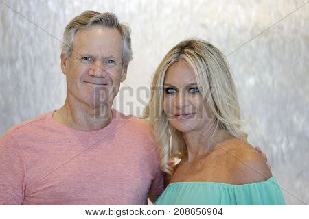 Happy Mature Couple In Studio Shot