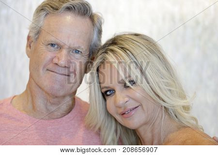 Portrait Of A Mature Couple Smiling At Camera
